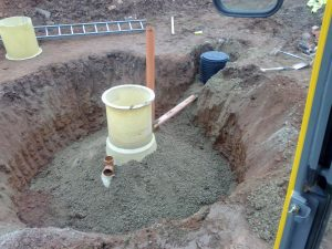 A waste treatment plant being buried