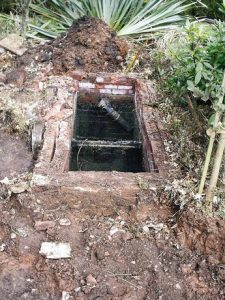 An old septic tank with the lid off needs more than septic tank cleaning, it needs replacement